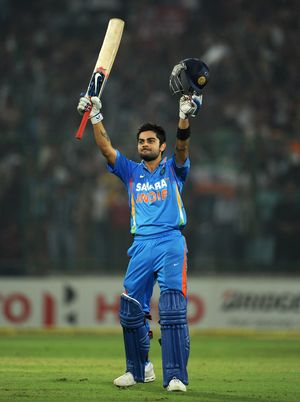 Virat Kohli Celebrates after scoring his century against West Indies in 2nd ODI