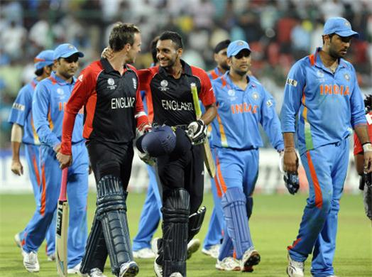 India Vs. England, ICC Cricket World Cup 2011 - Demoralized Indian Cricket Team walks out while jubilant English players waltz to the fame.