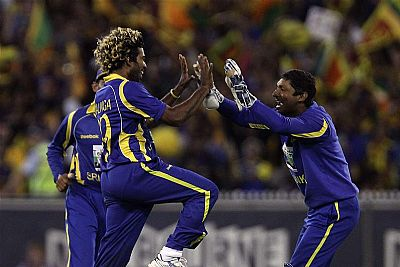 Sri Lankan players celebrate after defeating Australia to reach in the finals of Commonwealth Bank Series