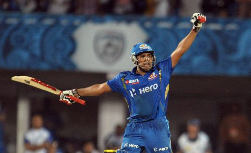Rohit sharma exults after hitting a last ball six