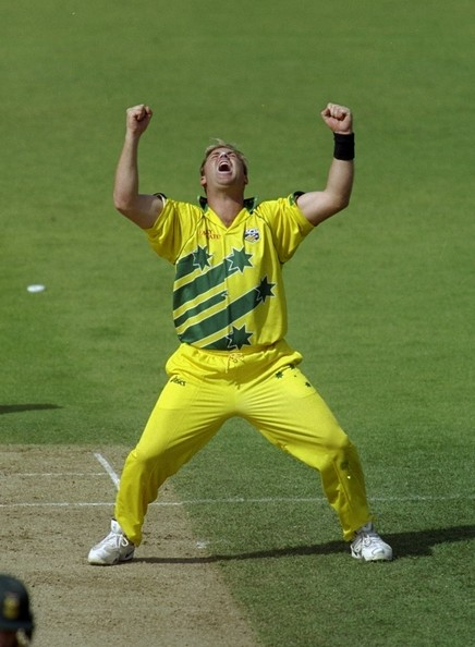 Shane Warne exults as he picks one of his four wickets