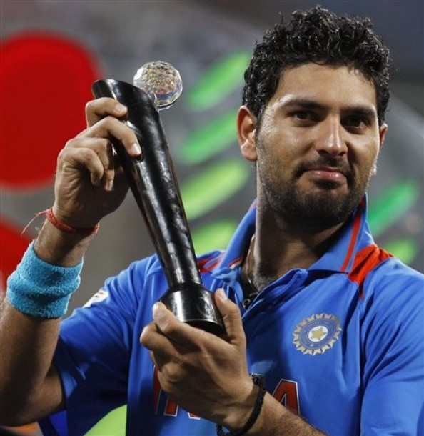 Yuvraj Singh with ICC World Cup 2011 Player of the Series Trophy